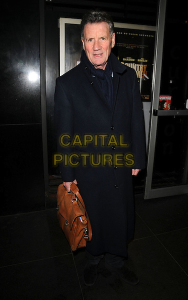"MICHAEL PALIN.The ""Battle For Haditha"" VIP screening, Curzon Soho cinema, London, England..January 31st, 2008.full length black coat jacket brown leather bag case satchel .CAP/CAN.©Can Nguyen/Capital Pictures"