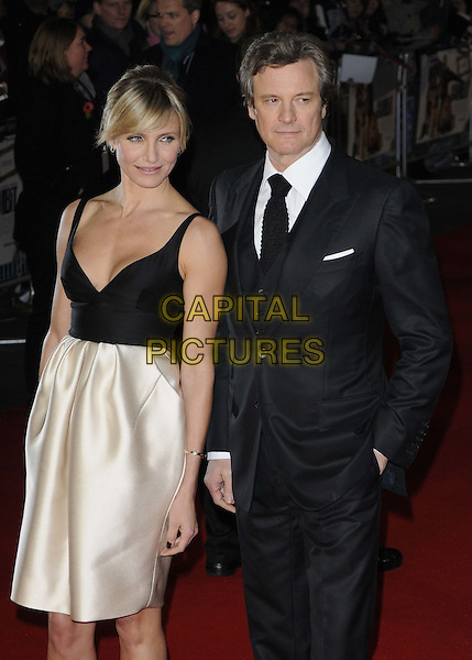 Cameron Diaz & Colin Firth.'Gambit' world film premiere Empire cinema, Leicester Square, London, England..7th November 2012.half length top silk satin white skirt black low cut neckline cleavage  suit shirt tie hand in pocket.CAP/CAN.©Can Nguyen/Capital Pictures.
