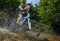 NWA Democrat-Gazette/BEN GOFF @NWABENGOFF<br /> Riders compete in the cross country races on Sunday July 17, 2016 during the 18th Annual Fat Tire Festival at Lake Leatherwood City Park in Eureka Springs.
