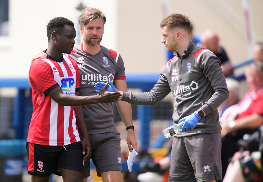 Lincoln City's trialist, left, with Lincoln City's assistant manager Nicky Cowley, centre, and Lincoln City's strength and conditioning/sports massage Kieran Walker<br /> <br /> Photographer Chris Vaughan/CameraSport<br /> <br /> Football Pre-Season Friendly (Community Festival of Lincolnshire) - Lincoln City v Lincoln United - Saturday 6th July 2019 - The Martin & Co Arena - Gainsborough<br /> <br /> World Copyright © 2018 CameraSport. All rights reserved. 43 Linden Ave. Countesthorpe. Leicester. England. LE8 5PG - Tel: +44 (0) 116 277 4147 - admin@camerasport.com - www.camerasport.com