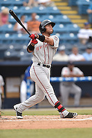 Greenville Drive second baseman Yoan Moncada (24) swings at a pitch during a game against the Asheville Tourists on July 12, 2015 in Asheville, North Carolina. The Drive defeated the Tourists 9-3. (Tony Farlow/Four Seam Images)