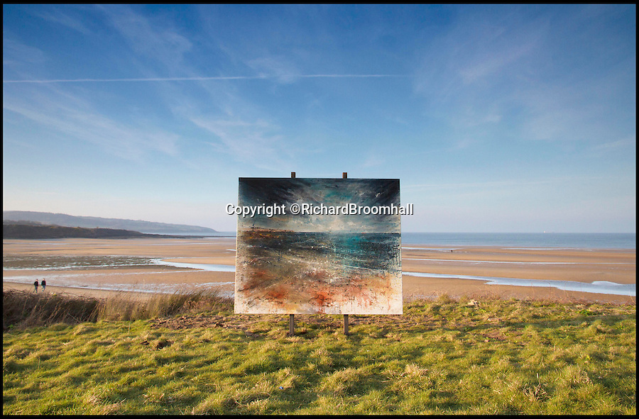 BNPS.co.uk (01202 558833)<br /> Pic: RichardBroomhall/BNPS<br /> <br /> Artist in Residence...Lligwy Bay.<br /> <br /> Artist Anthony Garratt is giving a whole new meaning to landscape painting - his incredible pieces aren't just of the landscape, they're in it too.<br /> <br /> The 35-year-old painter from Bristol has created four canvasses on the island of Anglesey as part of a new outdoor art installation and the paintings will remain in the exact spot they were painted until October.<br /> <br /> Mr Garratt spent several days on each of the giant 8ft-wide scenes, which are exposed to the elements and can be enjoyed by walkers as well as art fans. <br /> <br /> The landscapes had to be created on marine board - a thick marine plywood treated with sealant and epoxy, like a boat - rather than normal canvas, coated with five layers of varnish afterwards and mounted on bespoke steel frames to ensure they survive any harsh outdoor conditions.