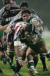 Waka Setitaia takes on Francis Bryant during the Air New Zealand rugby game between Counties Manukau Steelers & Manawatu, played at Mt Smart Stadium on the 22nd of September 2006. Counties Manukau 25 - Manawatu 25.