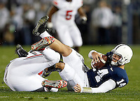 Ohio State Buckeyes defensive lineman Adolphus Washington (92) brings down Penn State Nittany Lions quarterback Christian Hackenberg (14) during the 4th quarter of the NCAA Division I football game at Beaver Stadium in University Park, PA on October 25, 2014. (Columbus Dispatch photo by Jonathan Quilter)