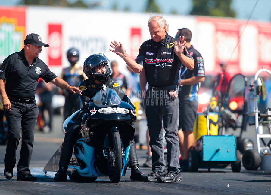 Jul 26, 2019; Sonoma, CA, USA; NHRA pro stock motorcycle rider Jianna Salinas with crew members during qualifying for the Sonoma Nationals at Sonoma Raceway. Mandatory Credit: Mark J. Rebilas-USA TODAY Sports