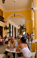 Havana capitol city of Cuba couple in bar with band in yellow cafe called Santo Angel in Old Havana