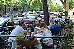Customers dine at Nookie's outdoor patio on North Wells Street, the main shopping thoroughfare in Old Town, in Chicago, Illinois on June 20, 2009.