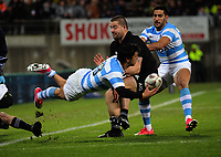 Matias Moroni tries to get a pass away as Dane Coles closes in during the Rugby Championship match between the NZ All Blacks and Argentina Pumas at Yarrow Stadium in New Plymouth, New Zealand on Saturday, 9 September 2017. Photo: Dave Lintott / lintottphoto.co.nz
