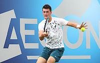 11.06.13 London, England. Bernard Tomic (AUS) in action against Benjamin Becker (GER) during the The Aegon Championships from the The QueenÕs Club in West Kensington.