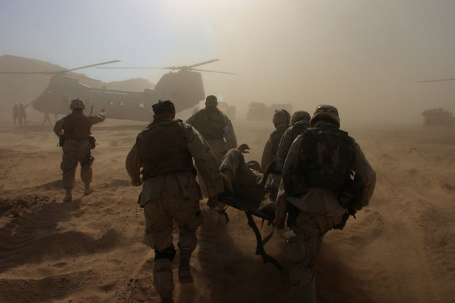 Marines rush a casualty to a waiting cas-evac helicopter for transport to a hospital in Babylon as the 11th MEU and supporting Army units began their final assault on the Imam Ali Shrine and its environs on August 25, 2004. The assault followed Moqtada al-Sadr?s rejection of an ultimatum from the Iraqi Interim Government demanding that the Mehdi Army withdraw from Najaf and the shrine.