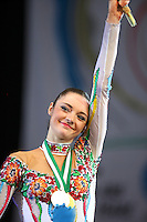 Anna Bessonova of Ukraine waves to fans during awards ceremony at 2009 World Cup at Portimao, Portugal on April 19, 2009.  (Photo by Tom Theobald).