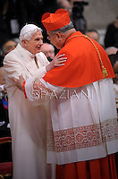 Brazilian cardinal Orani Joao Tempesta   is congratulated by Pope emeritus Benedict XVI  after he was appointed cardinal by the Pope at the consistory in the St. Peter's Basilica at the Vatican on February 22, 2014.