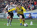 CELTIC'S KRIS COMMONS GETS AWAY FROM ST MIRREN'S DOUGIE IMRIE.