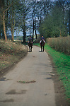 ADFTJ8 Two horse riders on country road