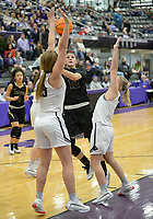 Bentonville's Natalie Smith (12) takes a shot Friday, Jan. 17, 2020, over Fayetteville's Claudia Bridges (right) and Caroline Lyles during the second half of play in Bulldog Arena in Fayetteville. Visit nwaonline.com/prepbball/ for a gallery from the games.<br /> (NWA Democrat-Gazette/Andy Shupe)