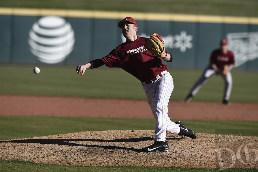 NWA Democrat-Gazette/MICHAEL WOODS @NWAMICHAELW<br /> University of Arkansas pitcher Angus Denton (29) fires a pitch Friday, January 27, during Razorback baseball teams first practice for the 2017 season at Baum Stadium.
