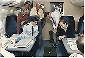 United States President Ronald Reagan putting a golf ball around Air Force One as he flies to Geneva, Switzerland for the US-Soviet Summit on November 16, 1985.  Recognizable in the photo, from left are: National Security Advisor Robert McFarland (in red shirt); Secretary of State George Schultz, White House Chief of Staff Donald Regan; The President; and unidentified.<br /> Credit: White House via CNP