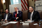 United States President Donald J. Trump sits between US Secretary of State Mike Pompeoo (R) and US Secretary of Health and Human Services Alex Azar during a Cabinet Meeting at the White House in Washington on October 21, 2019. <br /> Credit: Yuri Gripas / Pool via CNP