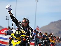 Apr 12, 2015; Las Vegas, NV, USA; NHRA funny car driver John Force celebrates after advancing to the final round of the Summitracing.com Nationals at The Strip at Las Vegas Motor Speedway. Mandatory Credit: Mark J. Rebilas-