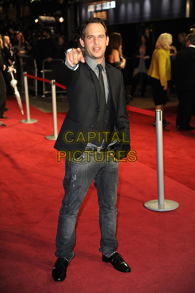 Moritz Bleibtreu.'360' opening gala premiere, 55th BFI London Film Festival, Odeon cinema, Leicester Square, London, England..October 12th 2011.full length black jacket jeans denim hand pointing arm waistcoat .CAP/CAS.©Bob Cass/Capital Pictures.