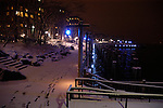 Snow on  a walkway along the river at night time. New York, USA.