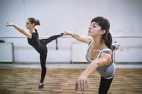 Two ballet students during a rehearsal at the training room of Kosovo Ballet, Kosovo National Theater, Pristina.