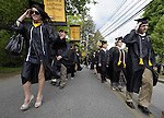 (Framingham 051913) Graduates hold on to their mortar boards as a guest of wind blows through, Sunday during the commencement ceremony at Framingham State University.  (Jim Michaud Photo)