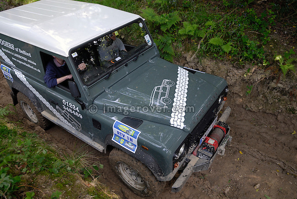 Land Rover Defender 90 TD4 competing at the ALRC National 2008 RTV Trial. The Association of Land Rover Clubs (ALRC) National Rallye is the biggest annual motor sport oriented Land Rover event and was hosted 2008 by the Midland Rover Owners Club at Eastnor Castle in Herefordshire, UK, 22 - 27 May 2008. --- No releases available. Automotive trademarks are the property of the trademark holder, authorization may be needed for some uses.