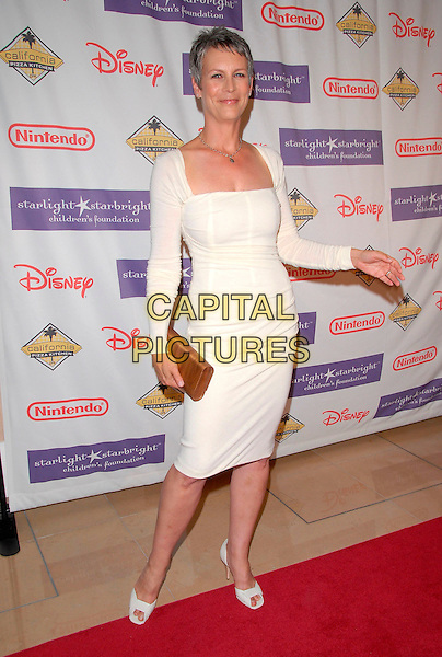 JAMIE LYNN CURTIS.At the 2007 Starlight Starbright Children's Foundation Gala held at the Beverly Hilton Hotel in Beverly Hills, California, USA, March 23 2007..full length white long sleeved dress shoes hand arm.CAP/DVS.©Debbie VanStory/Capital Pictures