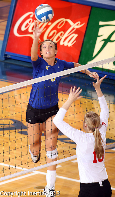 BROOKINGS, SD - OCTOBER 5:  Kacey Hermann #3 from South Dakota State University tips the ball against Kelsey Biloft #13 from the University of South Dakota in the second game of their match Saturday night at Frost Arena. (Photo by Dave Eggen/Inertia)