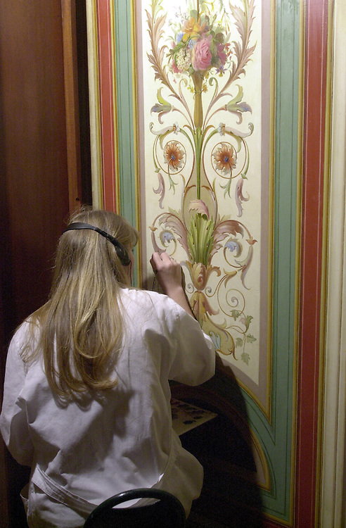 Restoration9(DG)092800 -- Working under contract with the Architect of the Capitol, artist Laurie Manos, ass. to Cunningham-Adams Fine Arts Painting Conservation, puts the finishing touches on the walls in the Brumidi Corridor of the Senate in the U.S. Capitol Thursday afternoon.