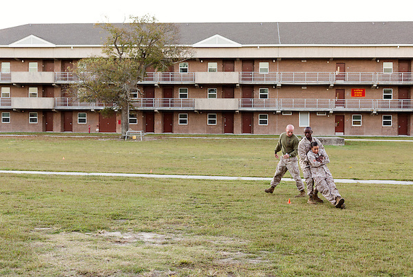 October 22, 2014. Camp LeJeune, North Carolina.<br />  Cpl. Raquel Mathieu, age 22, is dragged by another Marine of the Ground Combat Element Integrated Task Force during the Combat Fitness Test (CFT). The CFT includes a half mile run, followed by a series of timed physical tests that simulate conditions Marines could encounter in combat situations, such as removing a wounded Marine from the line of fire.<br />  The Ground Combat Element Integrated Task Force is a battalion level unit created in an effort to assess Marines in a series of physical and medical tests to establish baseline standards as the Corps analyze the best way to possibly integrate female Marines into combat arms occupational specialities, such as infantry personnel, for which they were previously not eligible. The unit will be comprised of approx. 650 Marines in total, with about 400 of those being volunteers, both male and female. <br />  Jeremy M. Lange for the Wall Street Journal<br /> COED