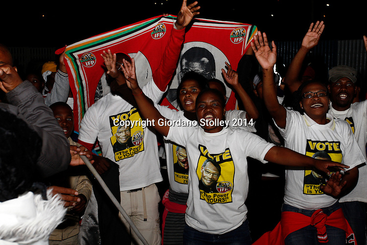 DURBAN - 5 May 2014 - Supporters of the Inkatha Freedom Party dance and cheer ahead of the arrival their leader Mangosuthu Buthelezi at a political rally in Durban's Umlazi Township. The country heads to the polls on May 7 and the IFP is trying to counter the effects of a breakawy faction that is expected to half its portion of the vote it obtained in the previous election in 2009. Picture Allied Picture Press/APP