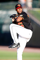 June 21, 2009:  Relief Pitcher Juan Morillo of the Rochester Red Wings delivers a pitch during a game at Frontier Field in Rochester, NY.  The Rochester Red Wings are the International League Triple-A affiliate of the Minnesota Twins.  Photo by:  Mike Janes/Four Seam Images