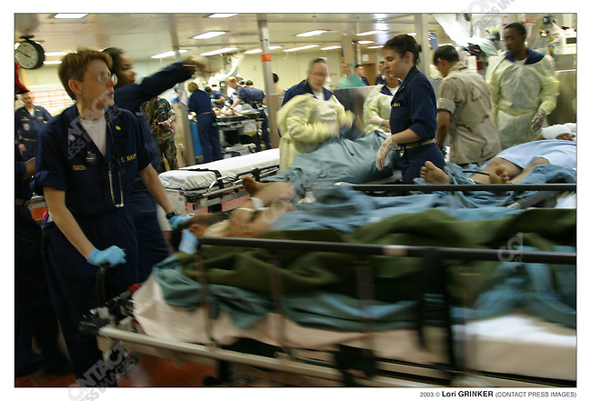 Iraqi patients (both civilians and POW's) are brought in to Casualty Receiving, (known on the ship as Casrec, the equivalent of a civilian hospital's ER). USNS COMFORT Naval hospital ship in the Persian Gulf.