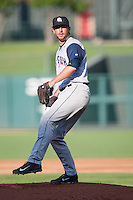 Colorado Springs Sky Sox pitcher Mike McClendon (36) winds up during the Pacific League game against the Oklahoma City RedHawks at the Chickasaw Bricktown Ballpark on August 3, 2014 in Oklahoma City, Oklahoma.  The RedHawks defeated the Sky Sox 8-1.  (William Purnell/Four Seam Images)