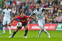 Saturday 17 August 2013<br /> <br /> Pictured: Chico is challenged by Ryan Giggs of Manchester United<br /> <br /> Re: Barclays Premier League Swansea City v Manchester United at the Liberty Stadium, Swansea, Wales
