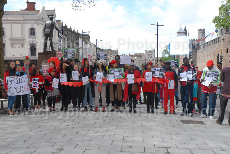"""The rally supporters spell out """"Bring Back Our Girls"""".<br /> <br /> Cardiff, South Wales. Sunday May 11th 2014. Nigerians in Cardiff in organised rally in support of the 276 abducted school children in Chibok, Nigeria by Boko Haram terrorists. <br /> <br /> Photo by Jeff Thomas/Jeff Thomas Photography"""