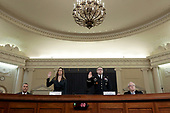 WASHINGTON, DC - NOVEMBER 19: Lt. Col. Alexander Vindman (R), National Security Council Director for European Affairs and Jennifer Williams (L), adviser to Vice President Mike Pence for European and Russian affairs, are sworn in prior to testifying before the House Intelligence Committee in the Longworth House Office Building on Capitol Hill November 19, 2019 in Washington, DC. The committee heard testimony during the third day of open hearings in the impeachment inquiry against U.S. President Donald Trump, who House Democrats say withheld U.S. military aid for Ukraine in exchange for Ukrainian investigations of his political rivals. <br /> Credit: Chip Somodevilla / Pool via CNP