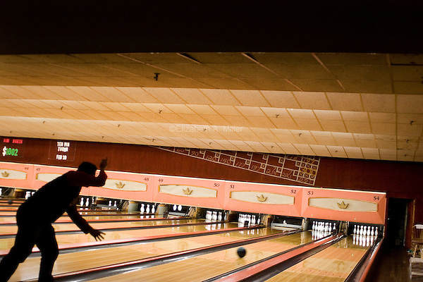 """Silhouette of man bowling at """"Lanes and Games."""""""