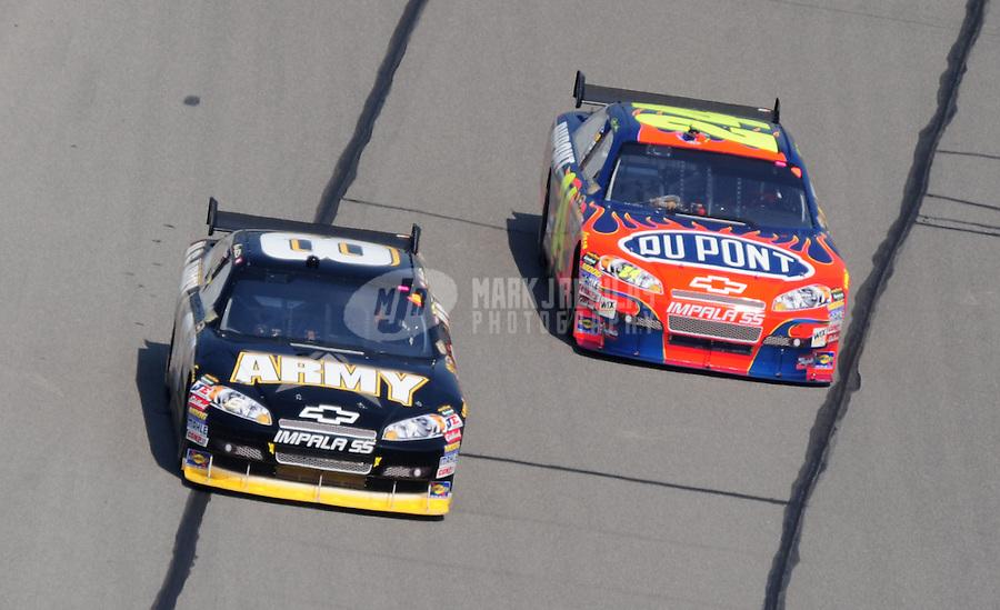 Sept. 28, 2008; Kansas City, KS, USA; Nascar Sprint Cup Series driver Mark Martin (8) races alongside Jeff Gordon (24) during the Camping World RV 400 at Kansas Speedway. Mandatory Credit: Mark J. Rebilas-