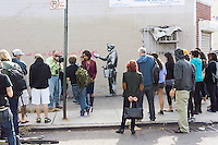 """Street art enthusiasts flock to the Woodside neighborhood of Queens in New York on Monday, October 14, 2013 to see the fourteenth installment of Banksy's graffiti art, """"What we do in life echoes in Eternity"""". The elusive street artist is creating works around the city each day during the month of October accompanied by a satirical recorded message which you can hear by calling the number 1-800-656-4271 followed by  # and the number of artwork.  (© Richard B. Levine)"""