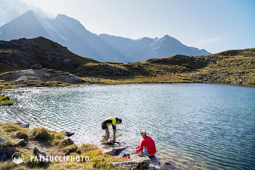 The Chamonix to Zermatt Glacier Haute Route. In late August 2017, we ran the tour in mountain running gear, running shoes, and all the necessary glacier travel and crevasse rescue gear. Cleaning up in the lake outside the Chanrion Hut.