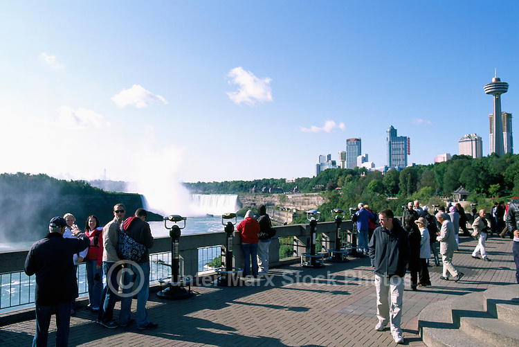 Tourists on Deck overlooking Niagara Falls (Canadian 'Horseshoe Falls') and the Niagara River, in the City of Niagara Falls, Ontario, Canada (Natural Wonder of the World)