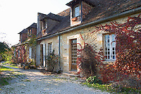 The farm house main building in traditional Dordogne style in afternoon sunshine and autumn colours. Ferme de Biorne duck and fowl farm Dordogne France