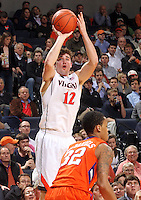 Virginia guard Joe Harris (12) shoots over Clemson forward K.J. McDaniels (32) during the game against Clemson Thursday in Charlottesville, VA. Virginia defeated Clemson 78-41.