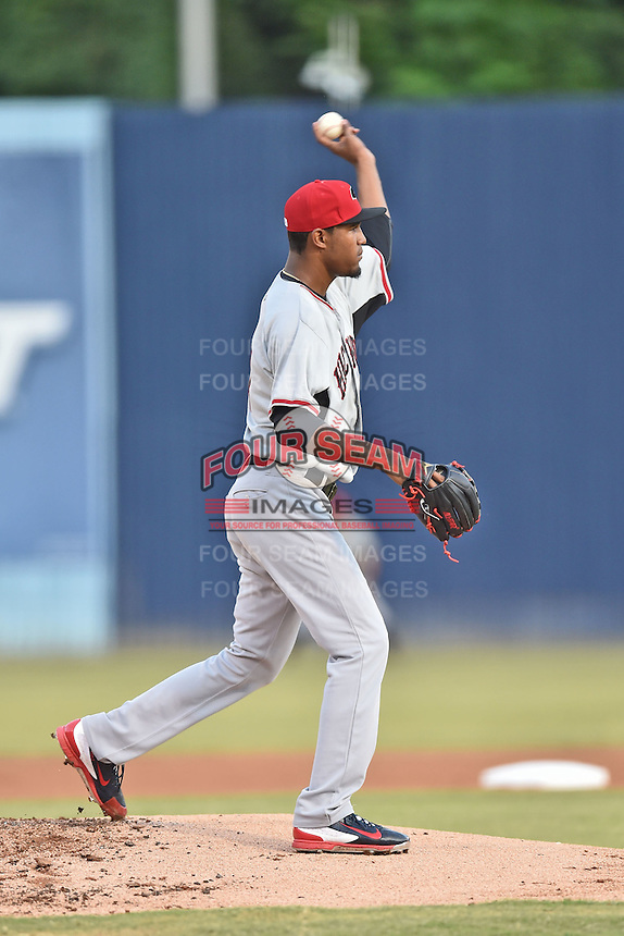 Hickory Crawdads starting pitcher Yohander Mendez (21) attempts a pickoff during game 3 of the South Atlantic League Championship Series between the Asheville Tourists and the Hickory Crawdads on September 17, 2015 in Asheville, North Carolina. The Crawdads defeated the Tourists 5-1 to win the championship. (Tony Farlow/Four Seam Images)