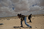 © Remi OCHLIK/IP3 -   Ajdabiya  March 22, 2011 - Fighters of rebellion hold position 9 kilometers from Adjabyia still at the and of Kadhafi loyalist army.