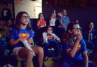 NWA Democrat-Gazette/BEN GOFF -- 05/29/15 Eva Konomi (front row from left), 8, and sisters Ellie Konomi, 3, and Eleni Konomi, 10, watch 'The Incredibles' during the Popcorn Theology program at The Neighborhood Church in Bentonville on Friday May 29, 2015. Popcorn Theology programs feature a movie, this time the film was 'The Incredibles,' followed by a discussion of where religious themes could be seen in the movie.
