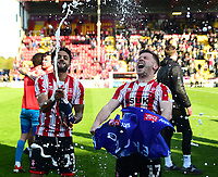 Lincoln City's Bruno Andrade, left, and Shay McCartan celebrate promotion<br /> <br /> Photographer Andrew Vaughan/CameraSport<br /> <br /> The EFL Sky Bet League Two - Lincoln City v Cheltenham Town - Saturday 13th April 2019 - Sincil Bank - Lincoln<br /> <br /> World Copyright &copy; 2019 CameraSport. All rights reserved. 43 Linden Ave. Countesthorpe. Leicester. England. LE8 5PG - Tel: +44 (0) 116 277 4147 - admin@camerasport.com - www.camerasport.com